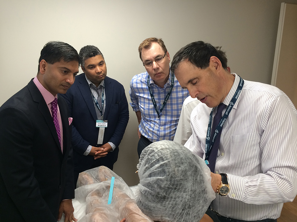 Dr. P and other doctors watching Instalift performed during training in Spain