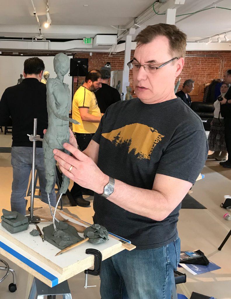 Dr. P sculpting a human figure